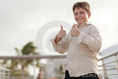 Young child showing two thumbs-up