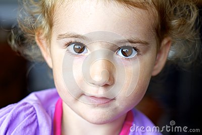 Young child, toddler, looking straight at camera, beautiful.