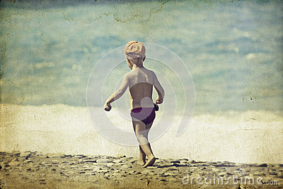 Young child walking on the beach