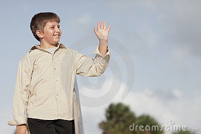 Young child waving