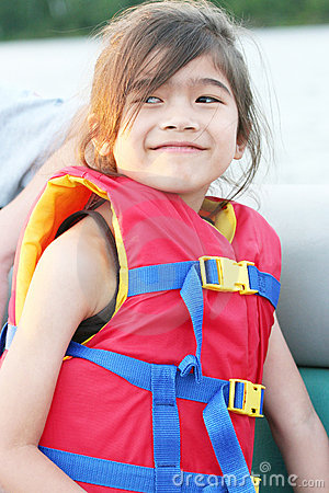 Young child wearing life vest