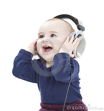Free Young Child With Ear-phones Listening To Music Royalty Free Stock Images - 24061189