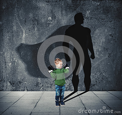 Free Young Child With His Shadow Of Super Hero On The Wall. Royalty Free Stock Photos - 97131548