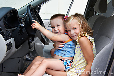 Young children are driving big cars