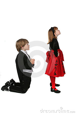Young children in formal clothes in arguement