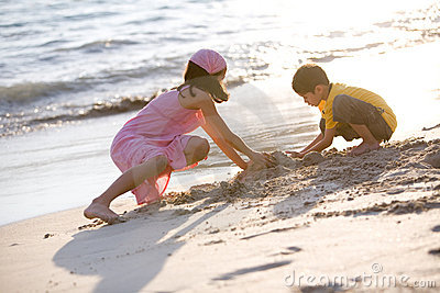 Young children making sand castle