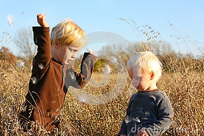 Young Children Playing Outside in Autumn