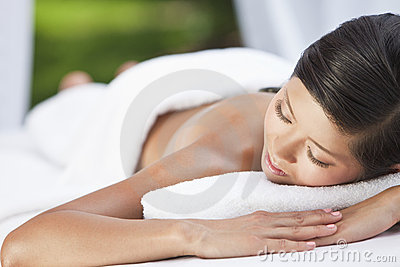 Young Chinese Asian Woman Relaxing At Health Spa
