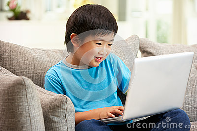 Young Chinese Boy Using Laptop