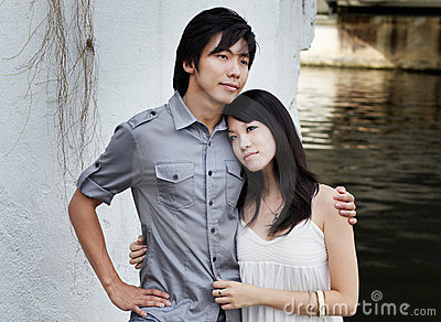 Young Chinese couple on romantic date by river