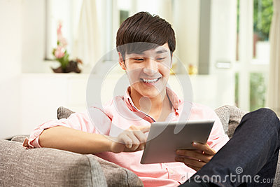 Young Chinese Man Using Digital Tablet