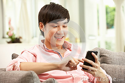 Young Chinese Man Using Mobile Phone