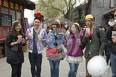 Young chinese Men and Women have fun in the entertainment district of Beijing Editorial Photo