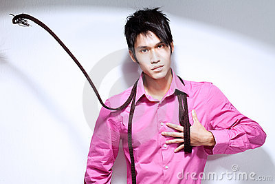 Young Chinese Metrosexual man in pink shirt