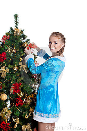 Young christmas girl decorate new year fir tree