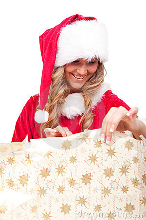 Young Christmas Woman is opening an xmas present
