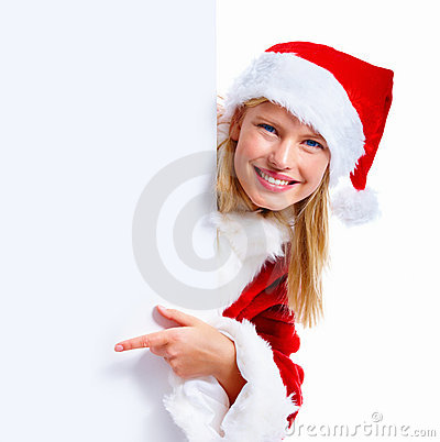 Young christmas woman pointing at a blank sign