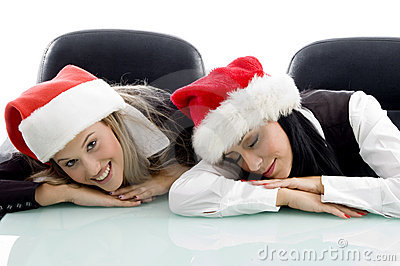 Young colleagues wearing christmas hat