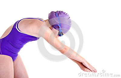 Young competitive swimmer in dive pose