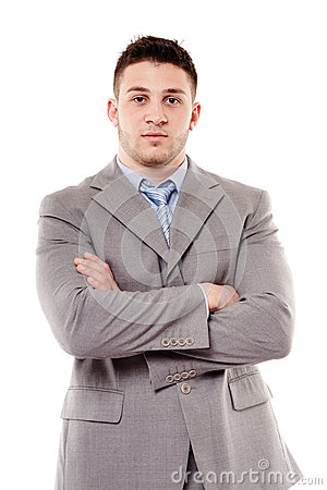 Young confident businessman with arms folded