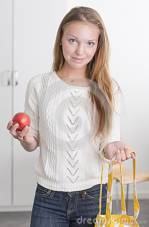Young confident woman with reusable shopping bag
