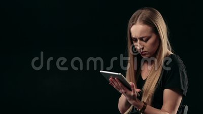 Young confident woman with the tablet pc isolated stock footage