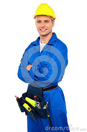 Free Young Contractor With Tool Set And Arms Crossed Stock Image - 26395571