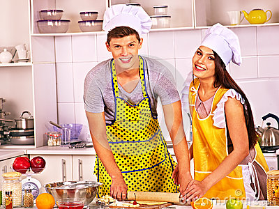 Young cook cooking at kitchen.