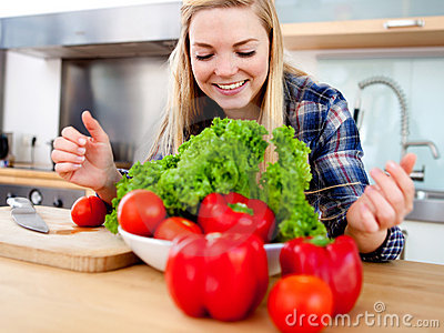 Young cook making salad
