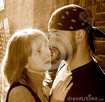Young couple against a brick wall