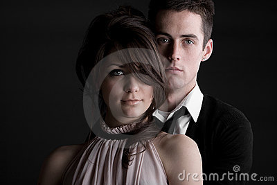 Young Couple against Dark Background