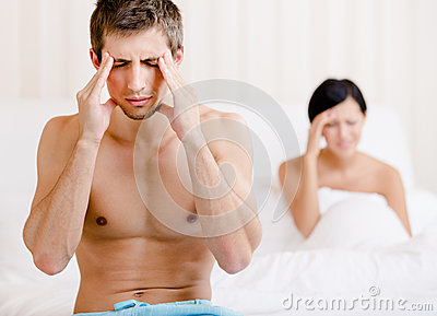 Young couple argues in bedroom