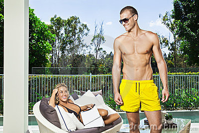 Young couple in backyard