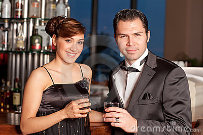 Young couple at bar drinking and flirting