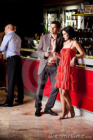 Young couple in bar having fun