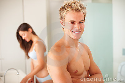 Young couple in the bathroom: Focus on man