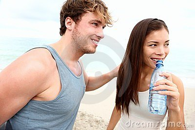 Young couple beach workout