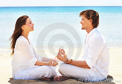 Young couple, beach and yoga