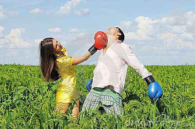 Young couple boxing