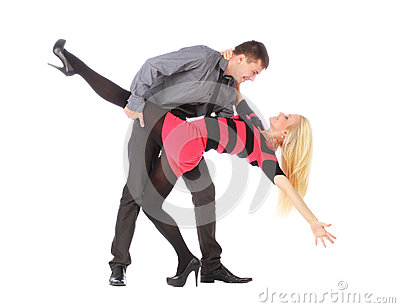 Young couple in business clothes on dancing pose