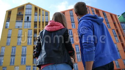 Young couple buying new apartment stock video footage