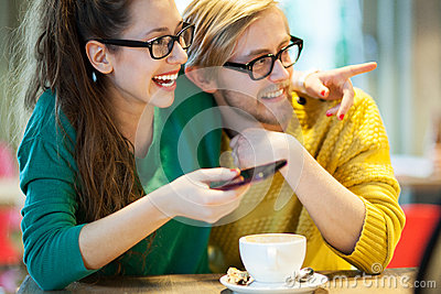 Young couple in cafe, laughing