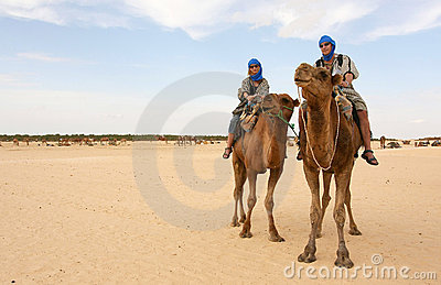 Young couple on camels