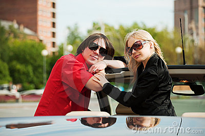 Happy young fashion couple in a convertible car Stock Photo