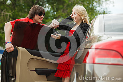 Young couple with a car