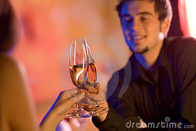 Young couple with champagne glasses in restaurant