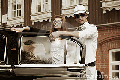 Young couple and classic car