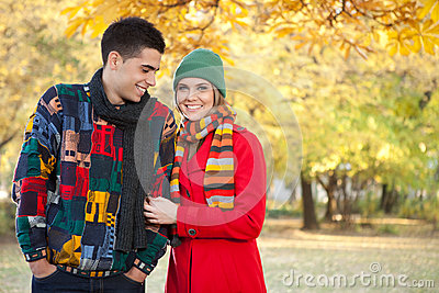 Young couple in cold autumn park