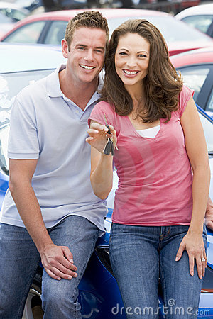 Free Young Couple Collecting New Car Royalty Free Stock Photos - 5096358