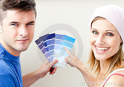 Young couple with color samples for painting room